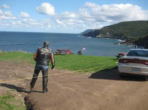 My friend Ron passes through the high security fencing, to the cliffs and campsites of Meat Cove Campground
