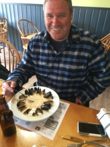 Paul Proctor showing how Coastal Waters Restaurant serves its chowder - lined with mussels!