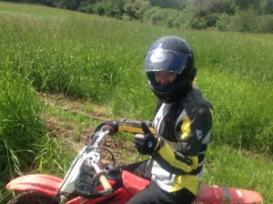 Lisa, from Framingham, MA riding my son's CRF70 around in my field at home in Arisaig... I think she got it stuck here!